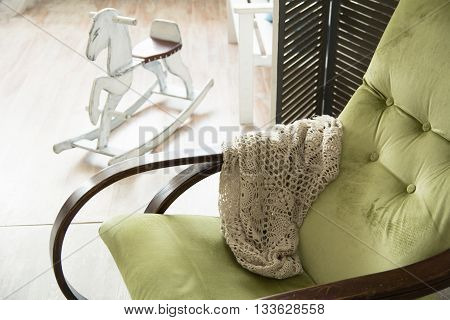 Close-up Of A Green Rocking Chair