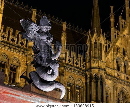 A statue of a putty in front of New Town Hall in Marienplatz Munich Germany