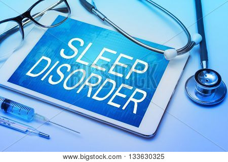 Sleep Disorder word on tablet screen with medical equipment on background