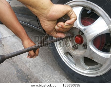 maintenance changing a tire car on road