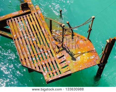 The old rusty metal construction dumped in the sea