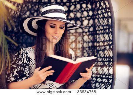 Beautiful Woman Reading a Book in Vacation Resort