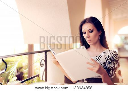 Surprised  Woman Choosing from Restaurant Menu Deciding What to Order