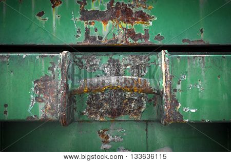 Details of an old dumpster with big rusty handle