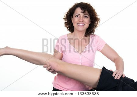 A Physiotherapist female stretching woman's leg isolated