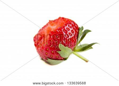 Bitten fresh red strawberry isolated on the white background