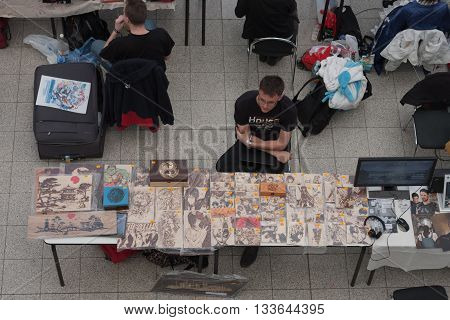 Salesman At Market With Anime Pyrography On Wood