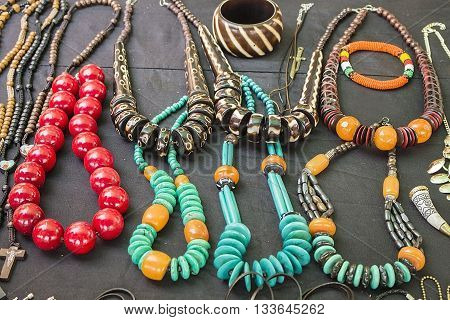 Local craft market in South Africa. Colorful beads bracelets bangles necklaces pendants. Craftsmanship. African fashion. Traditional ornament accessories.