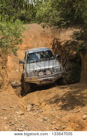 SOUTH AFRICA, HENNOPS -  FEBRUARY 6, 2016. Vehicle Toyota Hilux is doing off-road trail.