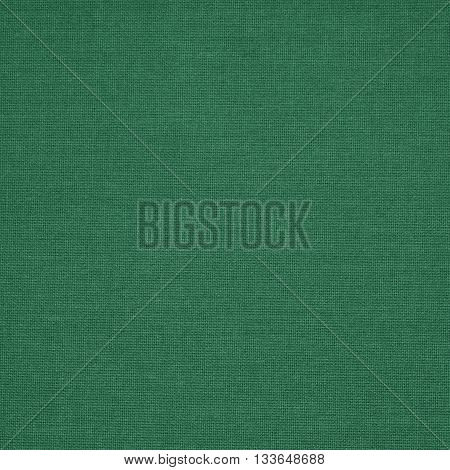 Background, pattern made of green woven fabric.
