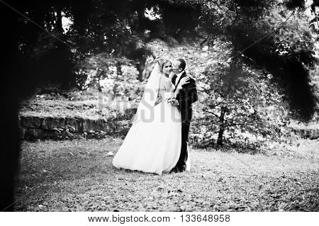 Newlywed on the background green vegetation under rain