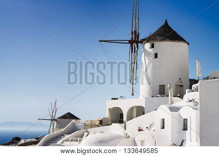 windmill of Oia at sunny day close up Santorini toned