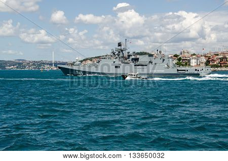 ISTANBUL TURKEY - JUNE 8 2016: The new Russian Navy frigate Admiral Grigorovich sailing rapidly along the Bosphorus past the famous Maiden's Tower at Uskudar in Istanbul Turkey. The warship is part of Russia's Black Sea Fleet.