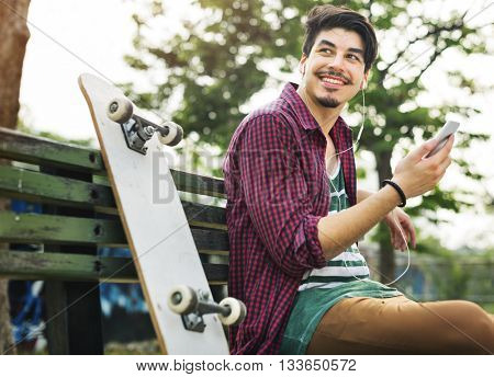 Young Skater Chilling Listening Concept