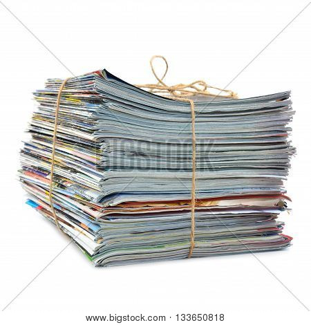 Stack of magazines tied with string, isolated on white background.