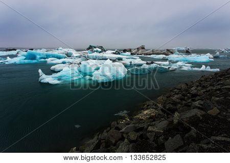 Glacier melting glacier lagoon Jokulsarlon Iceland, cloudy
