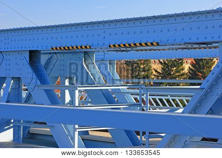 Riveted steel structure of a bridge in close up
