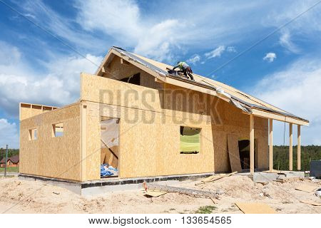 Construction or repair of house with insulation eaves windows garagechimney roofing fixing facade and plastering