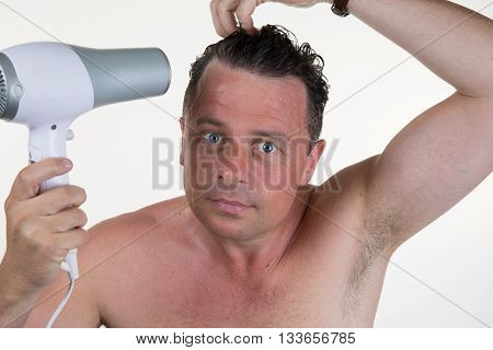 Man In His Bathroom On Morning With A Hair Dryer