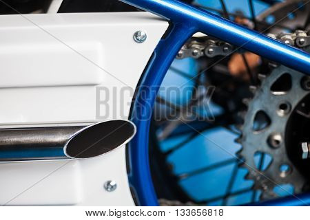 Color detail of a motorcycle exhaust pipe.