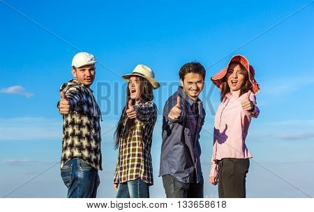 Diverse Multi-Ethnic Group of Young People Showing Thumbs Up Gesture Casual Relaxed Clothing Blue Sky Outdoor Background