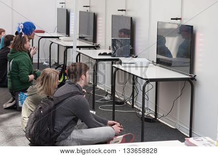 Unidentified Teenagers Playing Console Games At Animefest