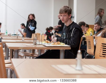 Young Teenager  Having Lunch In The Restaurant  At Animefest