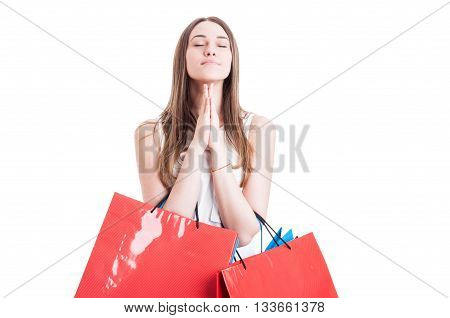 Attractive Girl With Shopping Bags Praying Or Making A Wish