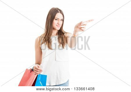 Beautiful Young Shopaholic Indicate Left Direction With Her Finger