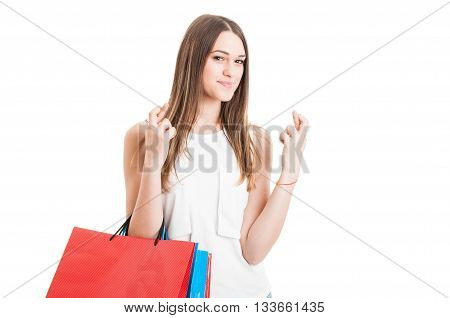 Attractive Smiling Female At Shopping Holding Finger Crossed