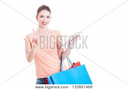 Shopper Lady Smiling And Showing Peace Sign Holding A Tablet