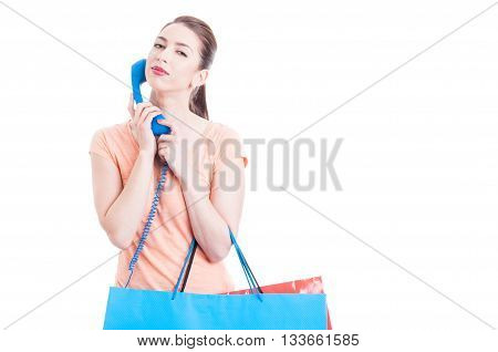 Woman At Shopping With Telephone As Calling For Assistance Concept
