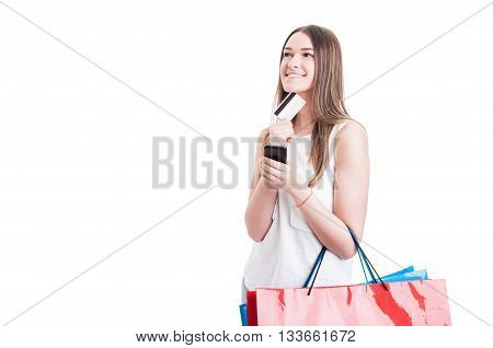 Young Caucasian Shopper With Credit Card And Smartphone