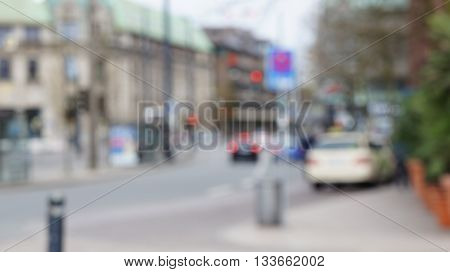 Blurry unfocused street scene in Germany. Taxi standing at taxi stand in the city center of Bremen. Historic buildings in the background.