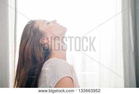 Portrait Of Young Woman Relaxing At Home. Casual Style Indoor Shoot