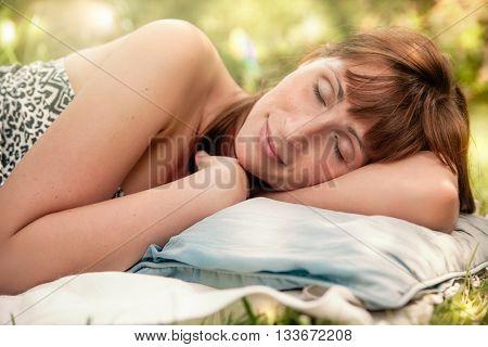 girl dreaming garden in summertime