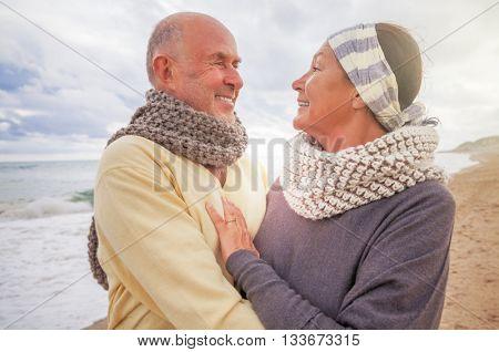 old senior couple outdoors on the coast