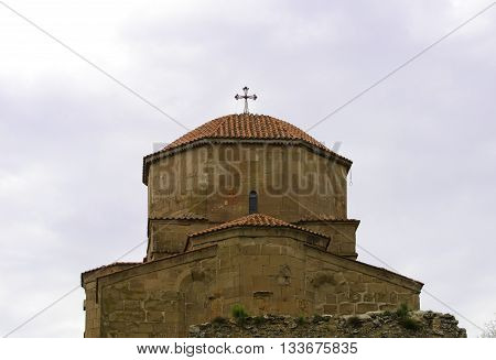 View of the dome of the ancient monastery Jvari against the sky