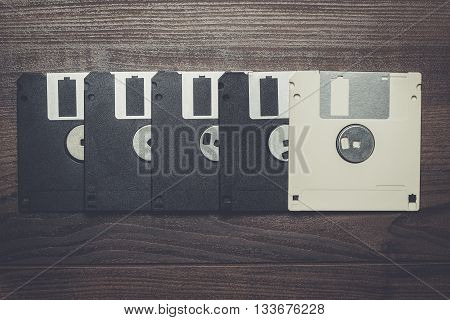 retro diskettes on the brown wooden background