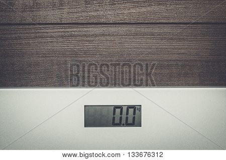 scales on the brown wooden floor background