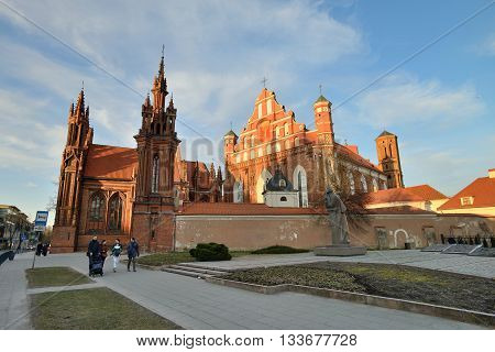 VILNIUS LITHUANIA - MARCH 18: Vilnius St Anne's and Bernardine Churches on March 18 2015 in Vilnius Lithuania. In 1994 the Vilnius Old Town was included in the UNESCO World Heritage List.