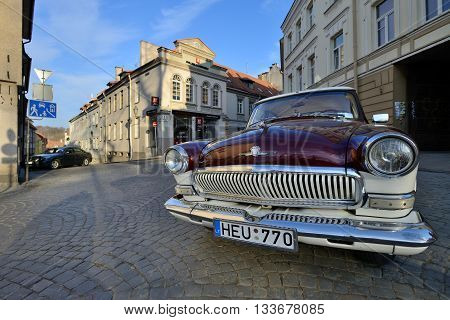 VILNIUS LITHUANIA - MARCH 18: exterior of the vintage Soviet car GAZ-21 Volga in Vilnius old town on March 18 2015 in Vilnius Lithuania.