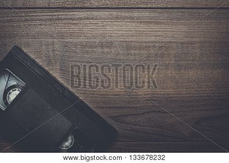 old retro video tape over brown wooden background