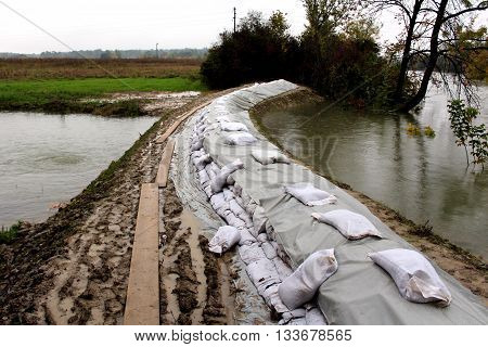 Preparing for flood with sandbags flood protection