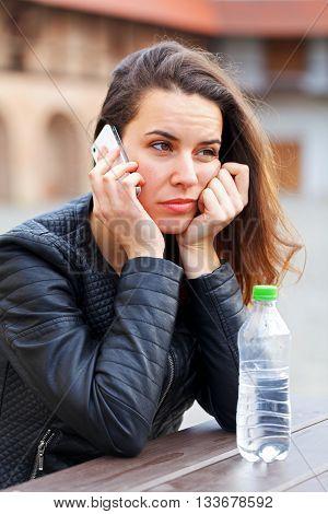 Upset beautiful woman talking on the phone