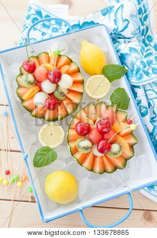 Fresh fruit salad in a cantaloupe melon cup