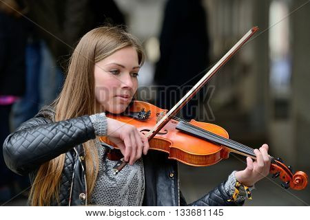 VILNIUS LITHUANIA - MAY 16: Unidentified musician play violin in Street music day on May 16 2015 in Vilnius. Its a most popular event on May in Vilnius Lithuania
