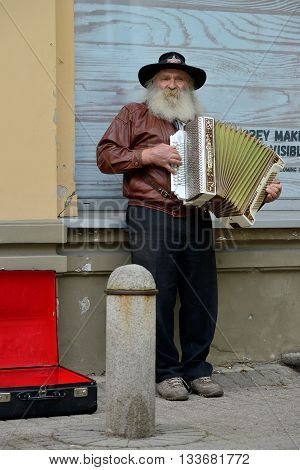 VILNIUS LITHUANIA - MAY 16: Unidentified musicians playing accordion in Street Music Day on May 16 2015 in Vilnius. Its a most popular event on May in Vilnius Lithuania