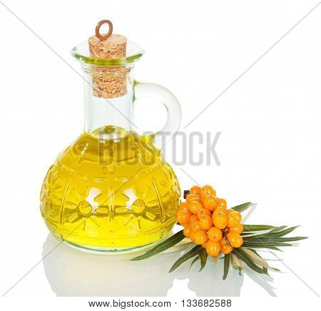 Decanter buckthorn oil isolated on white background.