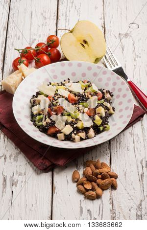 black rice salad with tomatoes apple almond and parmesan cheese